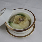 Seafood dumpling in supreme stock